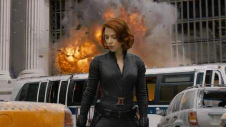 The Black Widow in front of an explosion from The Avengers