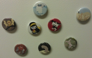St. Arwars, Wonder Woman, and Side Show buttons from Third Half Studios