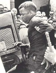 "John Lewis being arrested during the 1965 Selma-Montgomery March (""Bloody Sunday"")"
